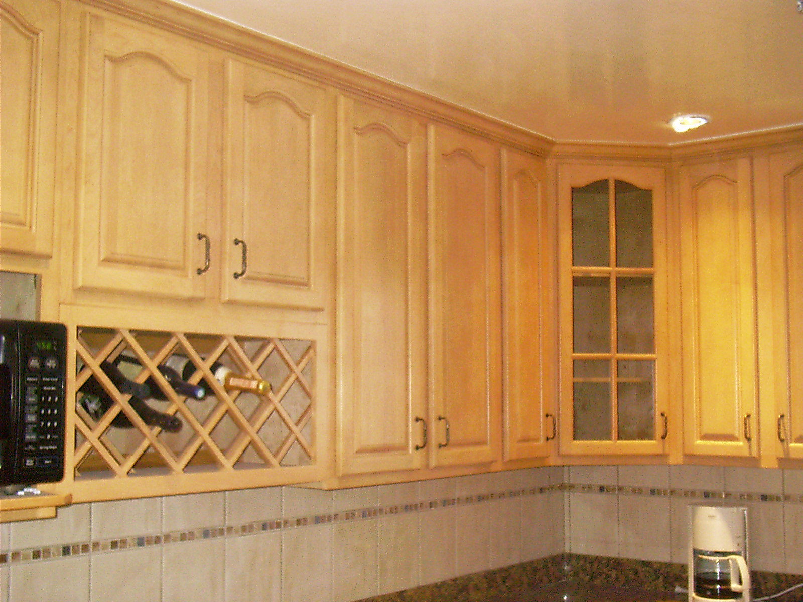 Kitchen With Black Cathedral Cabinet Doors